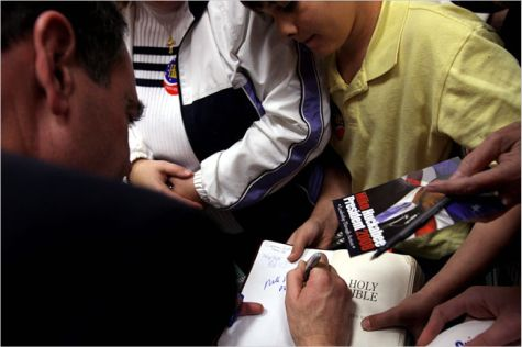 Mike Huckabee signs The Bible